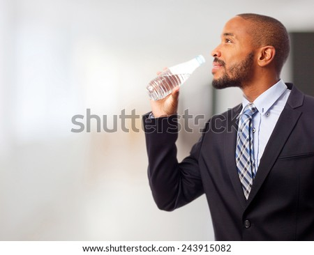 young cool black man drinking water - stock photo