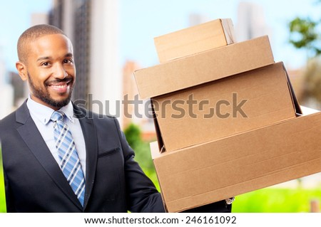 young cool black man with cardboardboxes