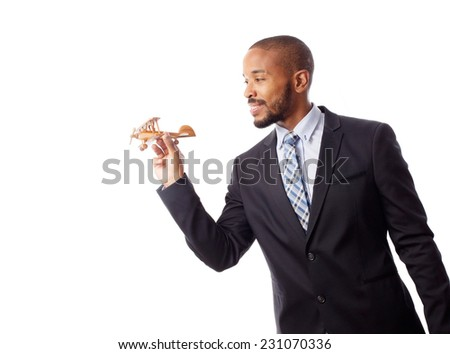 young cool black man with wooden plane