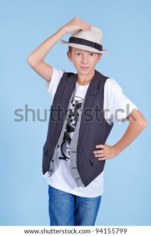 Young cool looking man in a suit and hat - stock photo