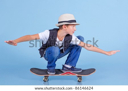 Young cool looking man on skateboard - stock photo