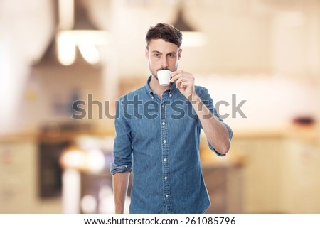 young cool man taking coffee - stock photo