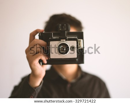 young cool man with a camera - stock photo