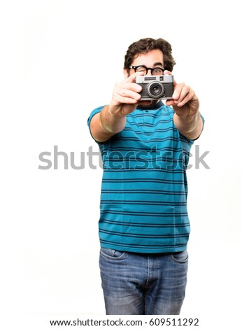 young cool man with a old photography camera