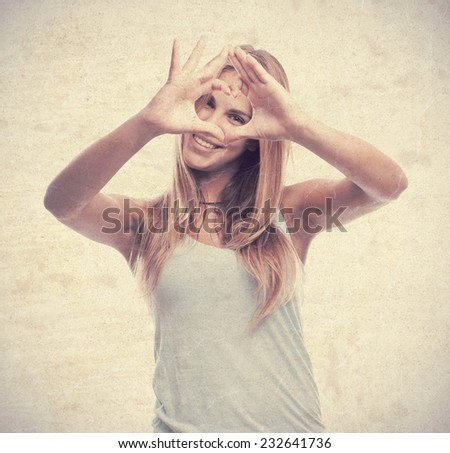young cool woman heart sign - stock photo