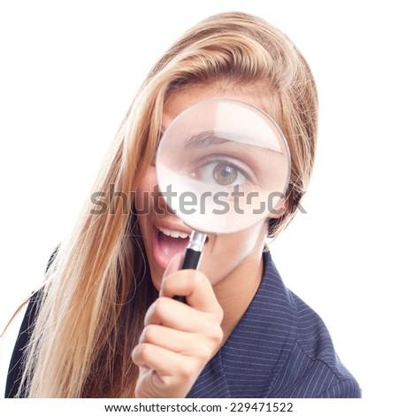 young cool woman with a magnifier at her eye