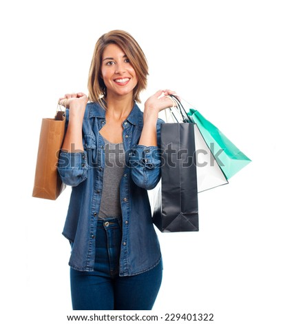 young cool woman with shopping bags - stock photo