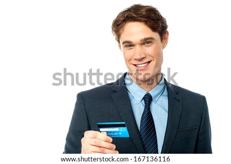 Young corporate guy cherishing his debit card