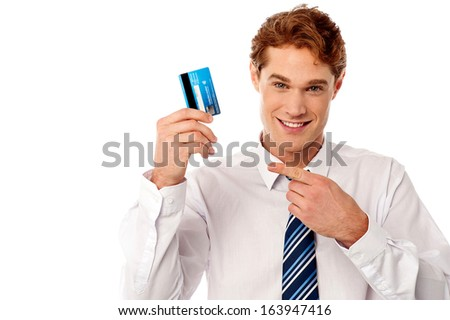 Young corporate guy displaying his debit card