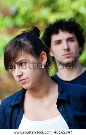 young couple after quarrel outside - stock photo