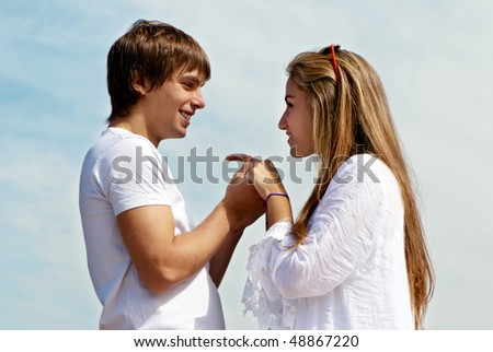 Young couple against the sky - stock photo