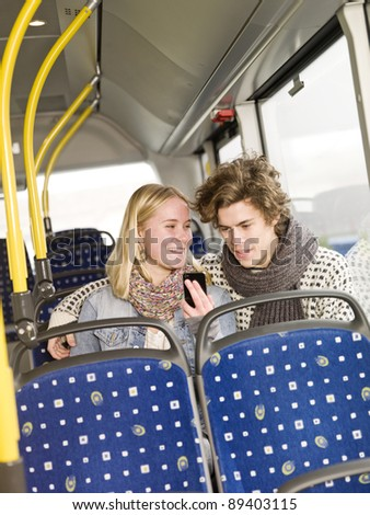 Young couple alone on the bus - stock photo