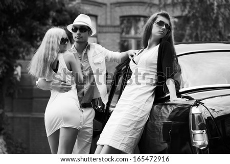 Young couple and jealous girl at the retro car - stock photo