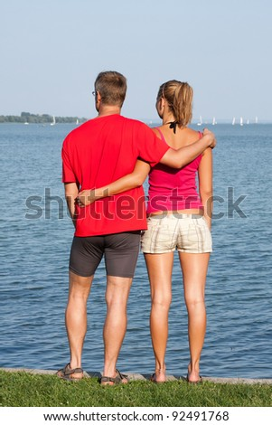 Young couple are of the lake - stock photo