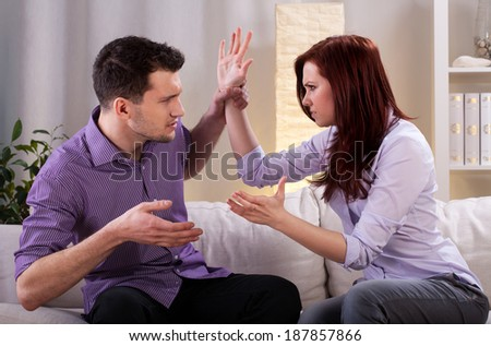 Young couple arguing and fighting at home - stock photo