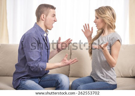 Young couple arguing in the room. Deception. Conflict. Quarrel. - stock photo