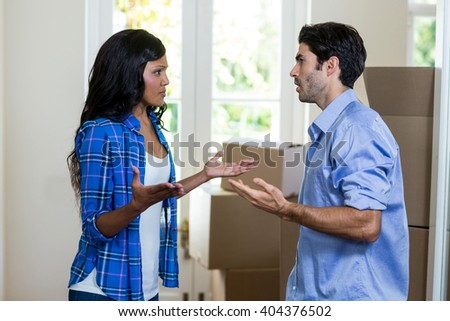Young couple arguing with each other at home - stock photo