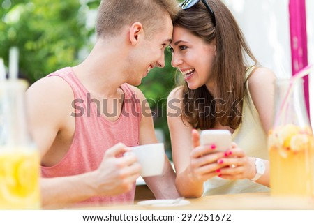 Young couple at outdoor cafe - stock photo
