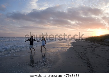 Young Couple at the Beach - stock photo