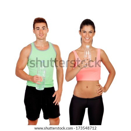 Young couple at the gym drinking water isolated on a white background