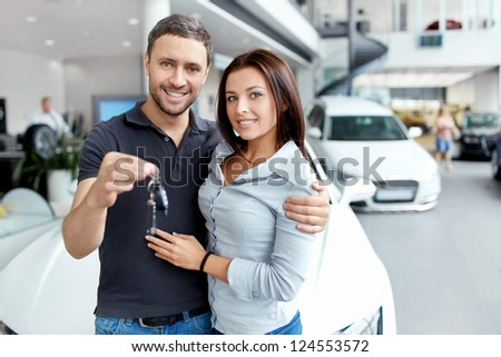 Young couple beside the car - stock photo
