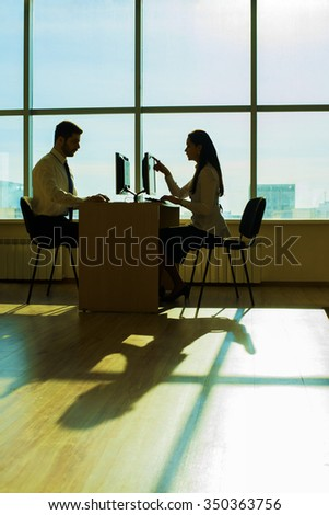 Young couple businessman on table solve theirs problem Handsome asian business man show new options capability on pc computer women sit at board in office room space type print text loot at screen - stock photo