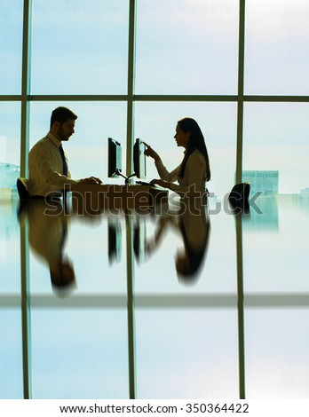 Young couple businessman on table solve theirs problem Handsome asian business man show new options capability on pc computer women sit at board in office room space type print text loot at screen
