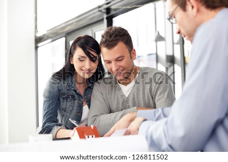 Young couple buying new home. Meeting with architect.