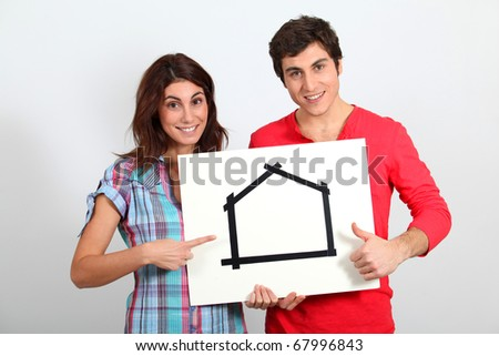 Young couple buying new house - stock photo