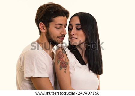 Young couple close up intimate studio portrait in a romantic mood. Filtered image. - stock photo