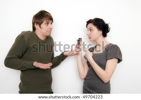 Young Couple Conversation, what is this on mobile? - stock photo