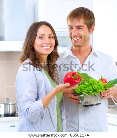 Young Couple Cooking Healthy food.Diet.Kitchen