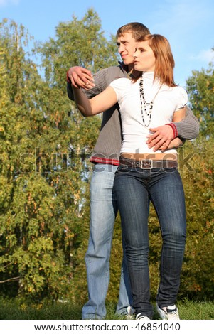 Young couple dancing in the park - stock photo