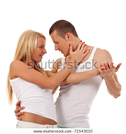 young couple dancing - man holding his girlfriend in a dance position - stock photo