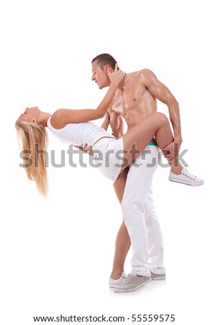 young couple dancing - shirtless man holding his girlfriend in a dance position - stock photo