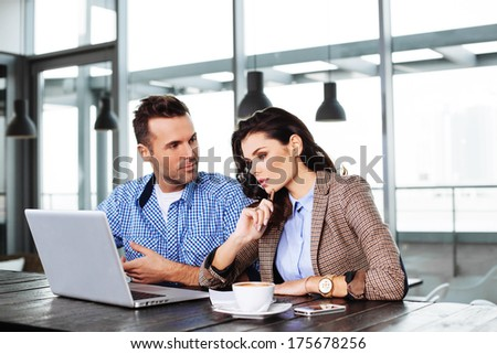 Young couple debating in front of the laptop - stock photo