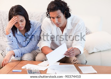 Young couple depressed about financial problems - stock photo