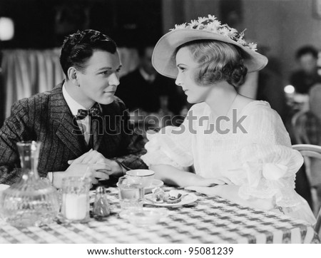 Young couple dining in restaurant - stock photo