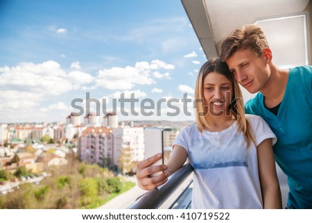 Young Couple Doing A Selfie On A Balcony
