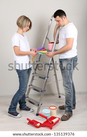 Young couple doing renovation together