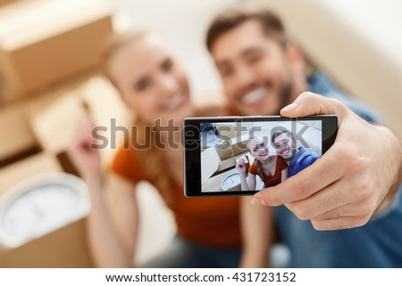 Young couple doing selfie