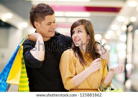 Young couple doing shopping - stock photo