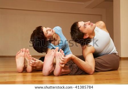 young couple doing yoga indoor - stock photo