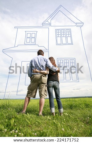 Young couple dreaming of new house. - stock photo