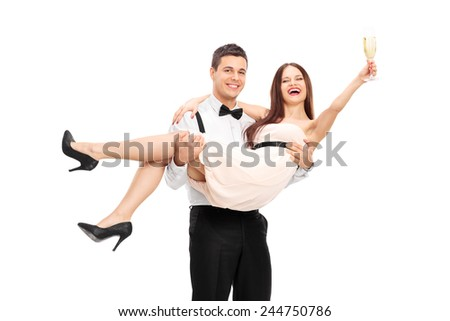Young couple drinking champagne and having fun isolated on white background - stock photo
