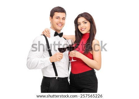 Young couple drinking red wine together isolated on white background - stock photo