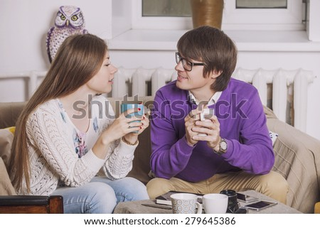 Young couple drinking tea in the discussion of ideas and plans