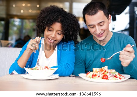 young couple eating lunch at restaurant