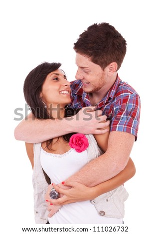 Young couple embracing and facing each other, isolated on white background - stock photo