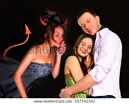 Young couple embracing in love. Devil whispering wrong things to them and trying to separate them. Pressure on relationship concept - stock photo